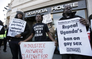 Demonstrators protest outside the Uganda